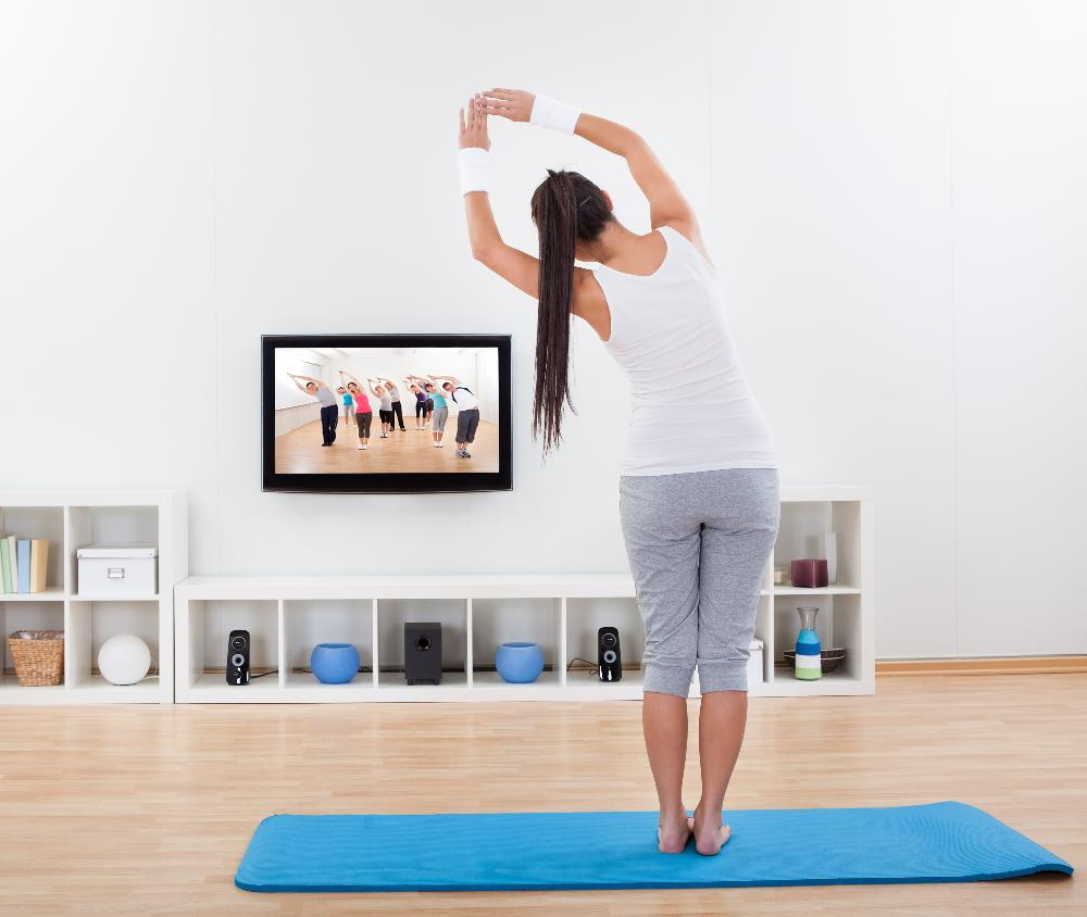 Woman doing exercise at home