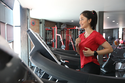 asian-women-running-sport-shoes-at-the-gym.jpg