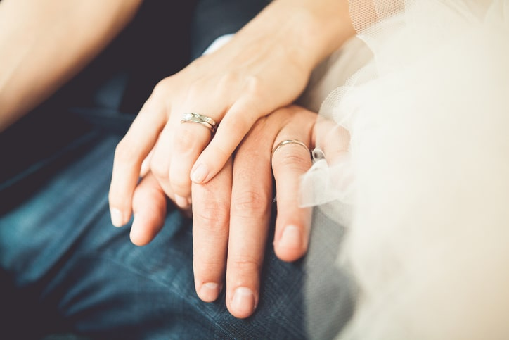 couple-holding-hands-showing-rings-aia-malaysia