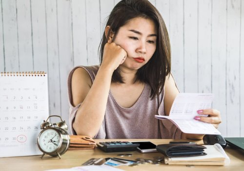 unemployment-asian-woman-paper-clock-unhappy-aia-malaysia.jpg