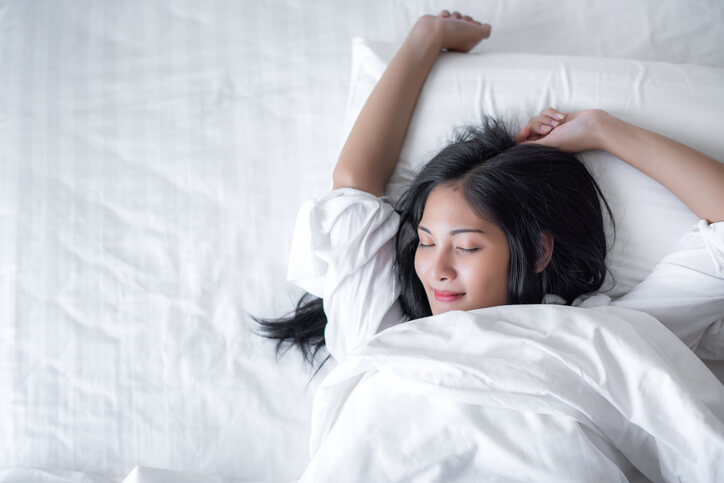 Woman Waking Up From Sleep