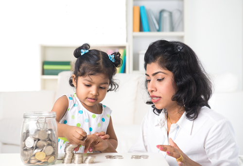 mother-teaching-daughter-on-financial