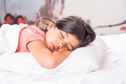 little girl asleep on pillow
