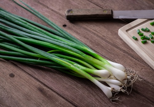 fresh-green-onion-on-wooden-table-aia-malaysia