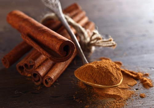 scents-that-can-do-wonders-for-your-wellbeing/cinnamon-sticks-and-powder-on-a-wooden-table-aia-malaysia